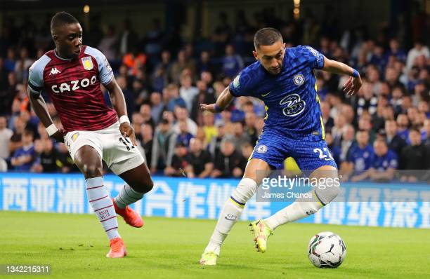Hakim Ziyech of Chelsea is challenged by Marvelous Nakamba of Aston Villa during the Carabao Cup Third Round match between Chelsea and Aston Villa at...