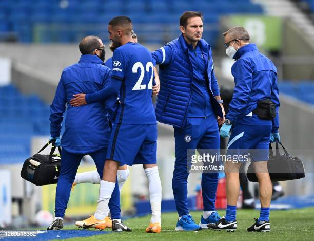 Hakim Ziyech of Chelsea is consoled by Frank Lampard Manager of Chelsea as he goes off injured during the preseason friendly between Brighton Hove...