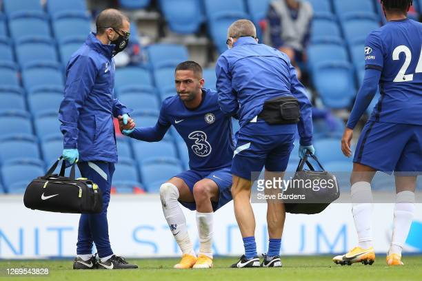 Hakim Ziyech of Chelsea receives treatment during the preseason friendly match at Amex Stadium on August 29 2020 in Brighton England A limited number...