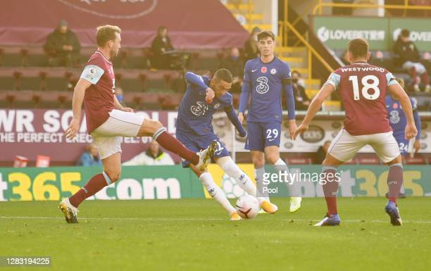 Hakim Ziyech of Chelsea scores his sides first goal during the Premier League match between Burnley and Chelsea at Turf Moor on October 31, 2020 in...