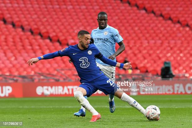 Hakim Ziyech of Chelsea scores his team's first goal whilst under pressure from Benjamin Mendy of Manchester City during the Semi Final of the...