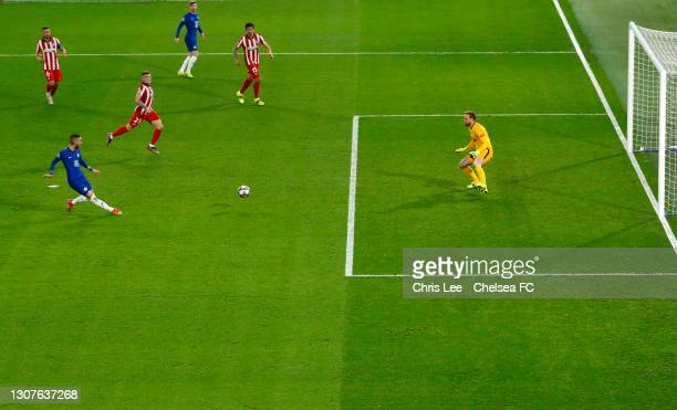 Hakim Ziyech of Chelsea scores their team's first goal past Jan Oblak of Atletico Madrid during the UEFA Champions League Round of 16 match between...
