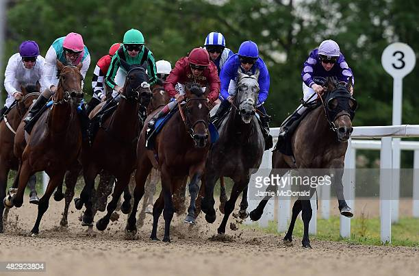 Hakka riden by Ted Durcan wins the Bet totequadpot hadicap stakes during racing at Chelmsford City Racecourse on August 4 2015 in Chelmsford England