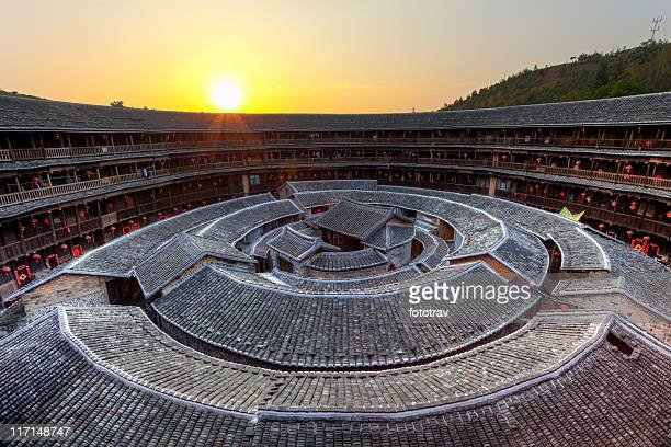 hakka tulou traditional chinese housing at sunset, fujian china - fujian tulou stock pictures, royalty-free photos & images