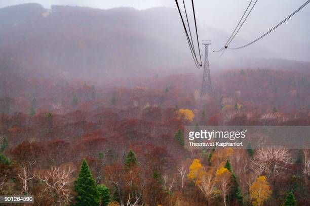 hakkoda ropeway with autumn colors , aomori prefecture, japan - iwate prefecture stock photos and pictures