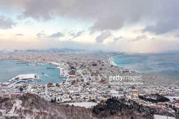hakodate city view from mountain hakodate, winter season, hokkaido, japan - landelement stockfoto's en -beelden