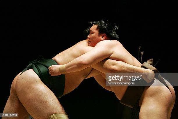 Hakuho and Katooshu lock up in a hold during their fourth round during the 2008 Grand Sumo Tournament at the Los Angeles Memorial Sports Arena on...