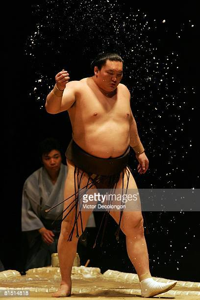 Hakuho purifies the dohyo with salt prior to his match against Katooshu in the fourth round during the 2008 Grand Sumo Tournament at the Los Angeles...