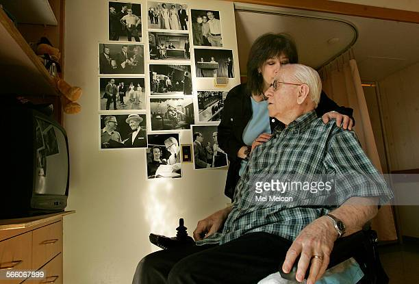 Hal Alexander a former TV stage manager and associate director gets a kiss from his daughter Brandy Alexander–Kern during a visit to his room at the...