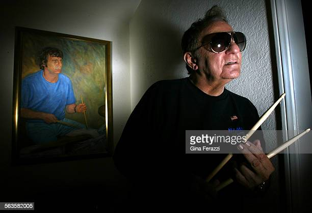 Hal Blaine one of the most famous drummers in the history of pop music poses in front of an oil painting of himself in younger days at his home in...
