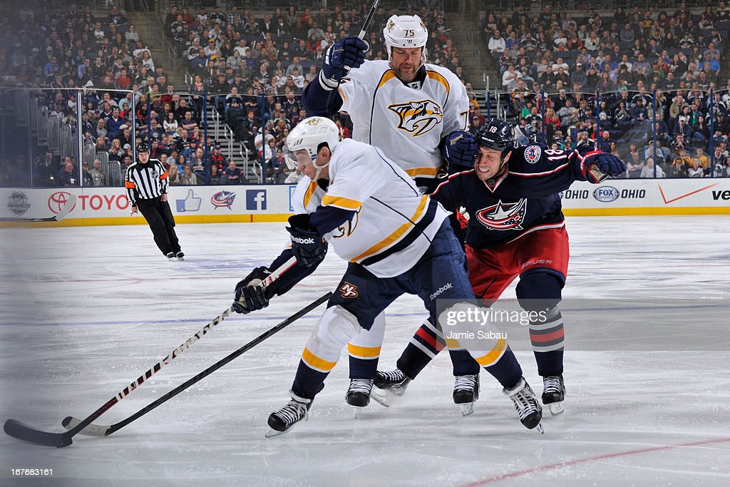 Hal Gill #75 of the Nashville Predators interferes with R.J. Umberger #18 of the Columbus Blue Jackets during the third period on April 27, 2013 at Nationwide Arena in Columbus, Ohio. Hal Gill was given a 2 minute minor for interference. Columbus defeated Nashville 3-1.