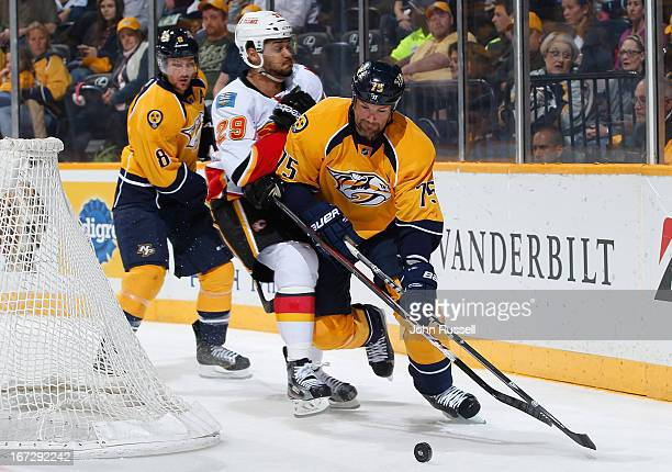 Hal Gill of the Nashville Predators skates against Akim Aliu of the Calgary Flames during an NHL game at the Bridgestone Arena on April 23 2013 in...