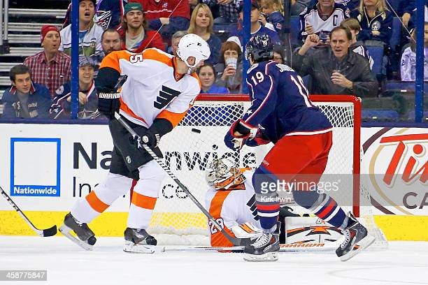 Hal Gill of the Philadelphia Flyers watches as Ryan Johansen of the Columbus Blue Jackets beats Ray Emery of the Philadelphia Flyers for a goal...