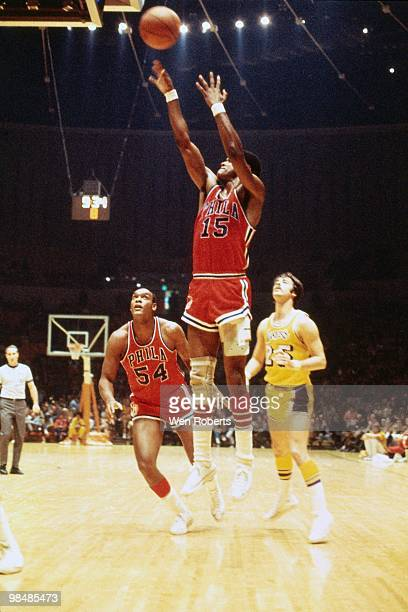 Hal Greer of the Philadelphia 76ers takes the shot as Luke Jackson of the 76ers and Gail Goodrich of the Los Angeles Lakers look on during an NBA...