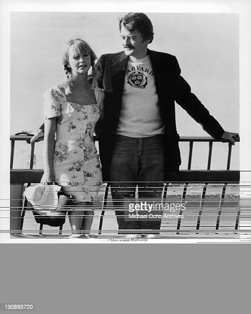 Hal Holbrook and Goldie Hawn standing together in a scene from the film 'The Girl From Petrovka' 1974