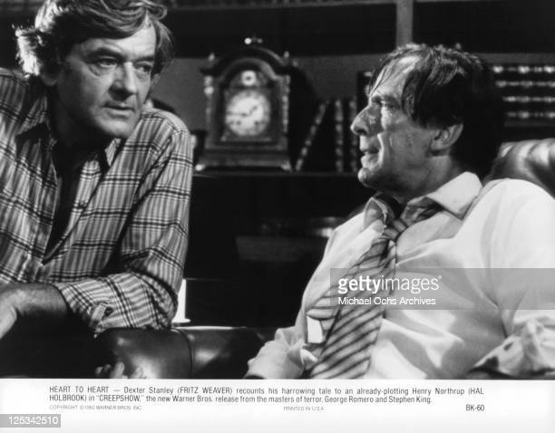 Hal Holbrook listens as Fritz Weaver recounts his harrowing tale in a scene from the film 'Creepshow' 1982