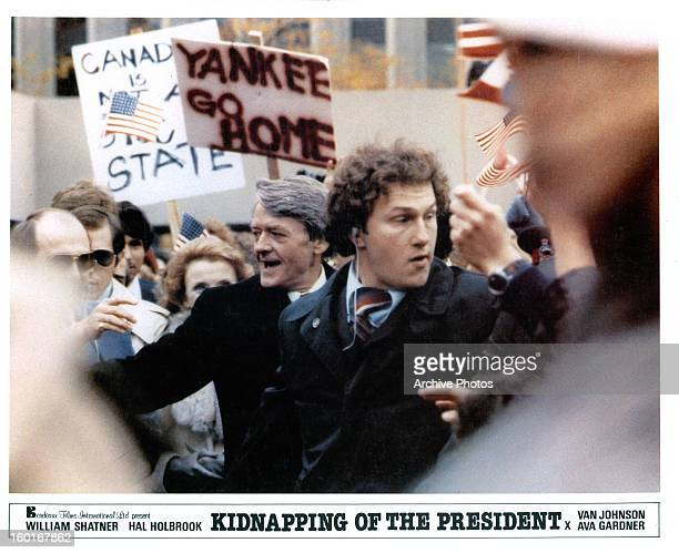Hal Holbrook navigates through a crowd in a scene from the film 'The Kidnapping Of The President' 1980