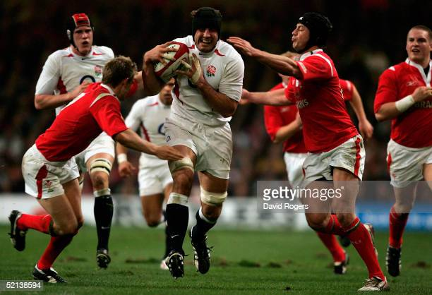 Hal Luscome and Dwayne Peel of Wales tackle Danny Grewcock of England during the RBS Six Nations International between Wales and England at The...