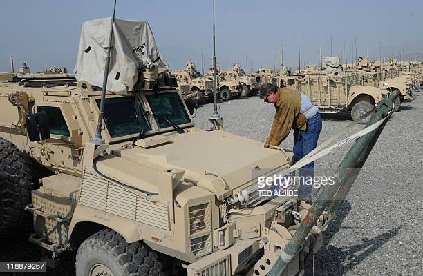 Hal Moore from AC first company a private contracting company tasked in repairing weapons and vehicles used by US soldiers in Afghanistan inspects a...