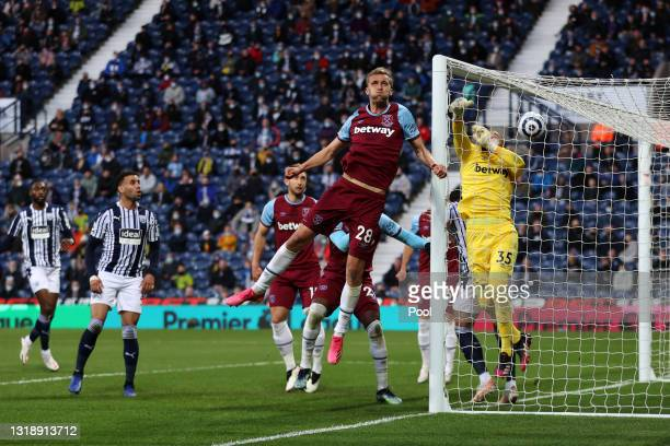 Hal Robson-Kanu and Kyle Bartley of West Bromwich Albion react as Matheus Pereira of West Bromwich Albion scores their first goal during the Premier...