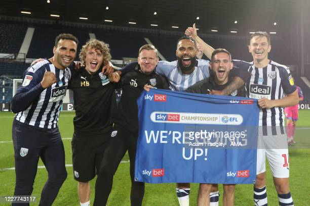 Hal RobsonKanu Kyle Bartley and Conor Townsend of West Bromwich Albion as the team celebrate promotion to the Premier League on the pitch at the end...