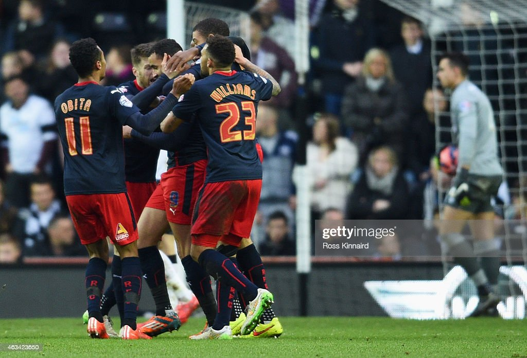 Hal Robson-Kanu of Reading (3L) celebrates with team mates as he scores their first goal during the FA Cup Fifth Round match between Derby County and Reading at iPro Stadium on February 14, 2015 in Derby, England.