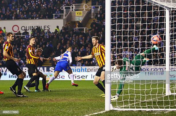 Hal RobsonKanu of Reading heads the opening goal during the FA Cup Quarter Final Replay match between Reading and Bradford City at Madejski Stadium...