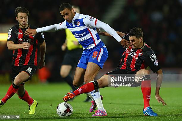 Hal RobsonKanu of Reading is closely watched by Tommy Elphick and Harry Arter of Bournemouth during the Sky Bet Championship match between AFC...
