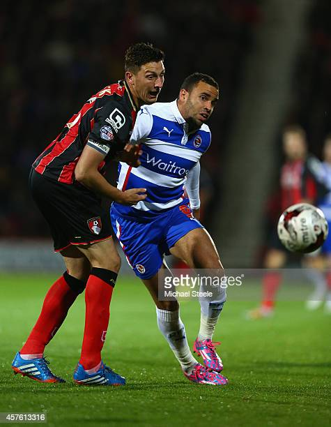 Hal RobsonKanu of Reading is tracked by Tommy Elphick of Bournemouth during the Sky Bet Championship match between AFC Bournemouth and Reading at...