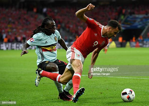 Hal RobsonKanu of Wales and Jordan Lukaku of Belgium compete for the ball during the UEFA EURO 2016 quarter final match between Wales and Belgium at...