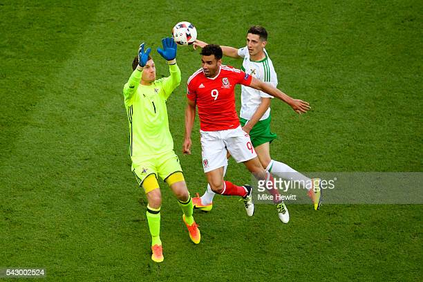 Hal Robson-Kanu of Wales and Michael McGovern of Northern Ireland compete for the ball during the UEFA EURO 2016 round of 16 match between Wales and...