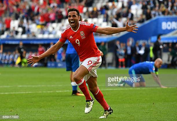 Hal RobsonKanu of Wales celebrates scoring his team's second goal during the UEFA EURO 2016 Group B match between Wales and Slovakia at Stade Matmut...