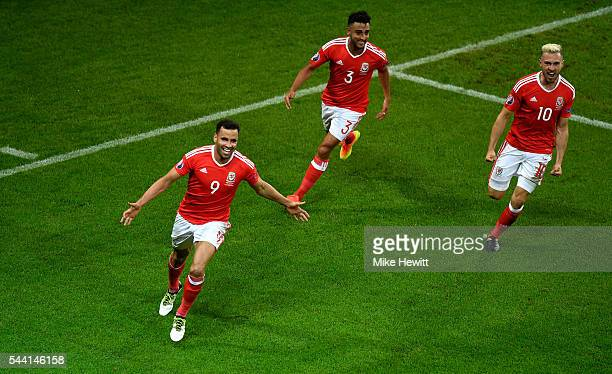 Hal RobsonKanu of Wales celebrates scoring his team's second goal during the UEFA EURO 2016 quarter final match between Wales and Belgium at Stade...