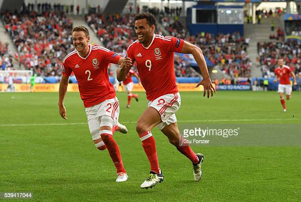 Hal RobsonKanu of Wales celebrates scoring his team's second goal with his team mate Chris Gunter during the UEFA EURO 2016 Group B match between...