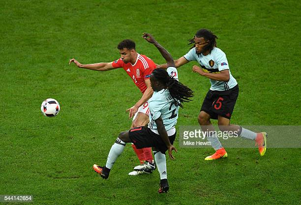 Hal RobsonKanu of Wales competes for the ball against Jordan Lukaku and Jason Denayer of Belgium during the UEFA EURO 2016 quarter final match...