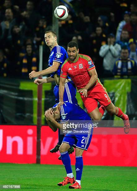 Hal RobsonKanu of Wales jumps for the ball against Toni Sunjic of Bosnia of the Euro 2016 qualifying football match between Bosnia and Herzegovina...