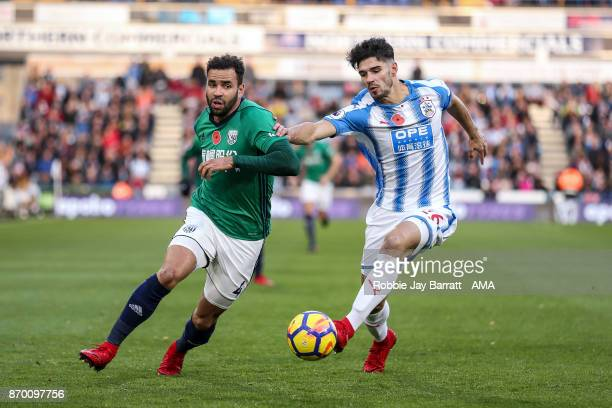 Hal RobsonKanu of West Bromwich Albion and Christopher Schindler of Huddersfield Town during the Premier League match between Huddersfield Town and...