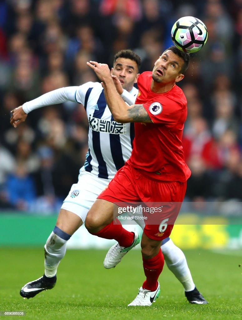 Hal Robson-Kanu of West Bromwich Albion and Dejan Lovren of Liverpool battle for possession during the Premier League match between West Bromwich Albion and Liverpool at The Hawthorns on April 16, 2017 in West Bromwich, England.
