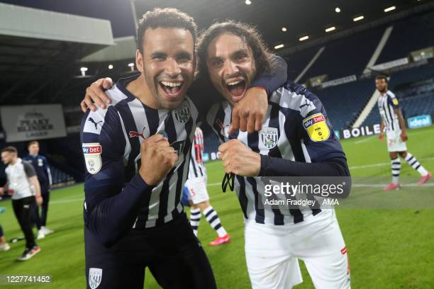 Hal RobsonKanu of West Bromwich Albion and Filip Krovinovic of West Bromwich Albion celebrate promotion to the Premier League on the pitch at the end...