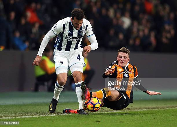 Hal RobsonKanu of West Bromwich Albion and Josh Tymon of Hull City battle for possession during the Premier League match between Hull City and West...