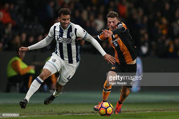 Hal RobsonKanu of West Bromwich Albion and Josh Tymon of Hull City compete for the ball during the Premier League match between Hull City and West...