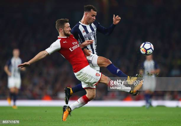 Hal RobsonKanu of West Bromwich Albion and Shkodran Mustafi of Arsenal battle for the ball during the Premier League match between Arsenal and West...