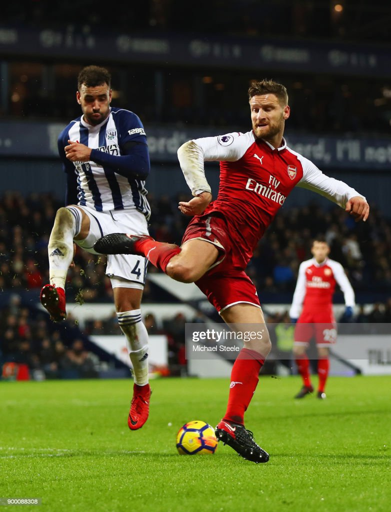 Hal Robson-Kanu of West Bromwich Albion and Shkodran Mustafi of Arsenal battle for the ball during the Premier League match between West Bromwich Albion and Arsenal at The Hawthorns on December 31, 2017 in West Bromwich, England.