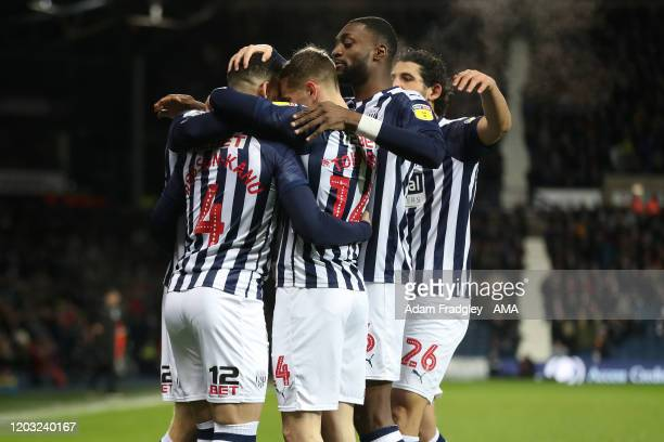 Hal RobsonKanu of West Bromwich Albion celebrates after scoring a goal to make it 10 with team mates during the Sky Bet Championship match between...