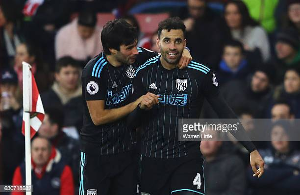 Hal RobsonKanu of West Bromwich Albion celebrates scoring his side's second goal with his team mate Claudio Yacob during the Premier League match...