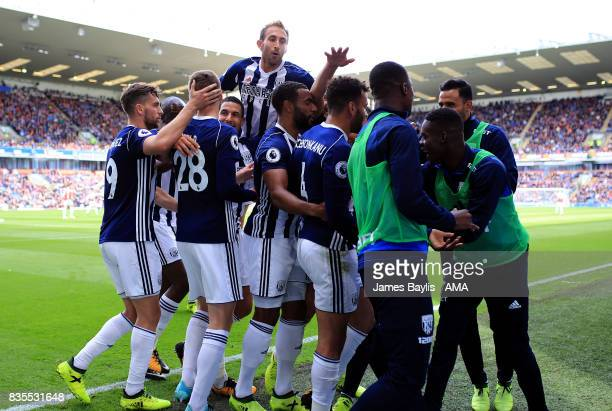 Hal RobsonKanu of West Bromwich Albion celebrates with his team mates after scoring a goal to make it 01 during the Premier League match between...