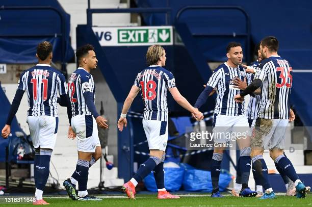 Hal Robson-Kanu of West Bromwich Albion celebrates with team mates after scoring their side's first goal during the Premier League match between West...
