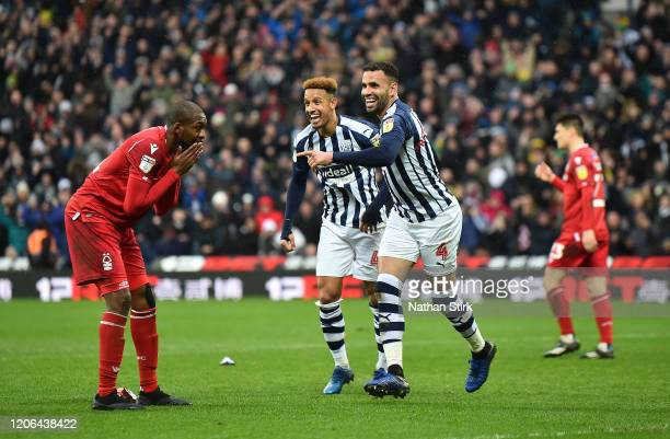 Hal Robson-Kanu of West Bromwich Albion celebrates with teammate Callum Robinson after scoring their teams second goal during the Sky Bet...