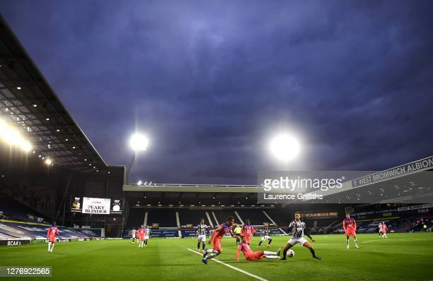 Hal Robson-Kanu of West Bromwich Albion competes fore the ball with Thiago Silva and Cesar Azpilicueta of Chelsea during the Premier League match...