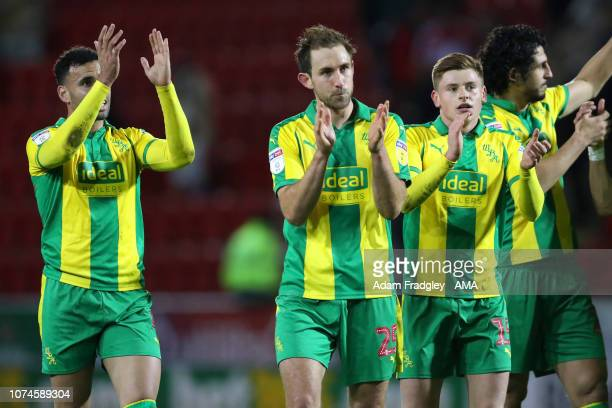 Hal RobsonKanu of West Bromwich Albion Craig Dawson of West Bromwich Albion and Harvey Barnes of West Bromwich Albion applaud the travelling West...
